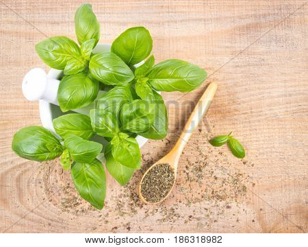 Raw Green Basil And Dried, On The Wooden Table.