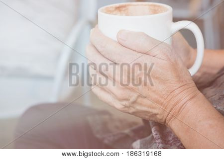 Asian Elderly Woman Sitting And Resting In Cafe Coffee Shop With Cup Of Coffee In Elder Senior Lady