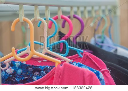 Clothes wet hanging on clothes line basks in sun.