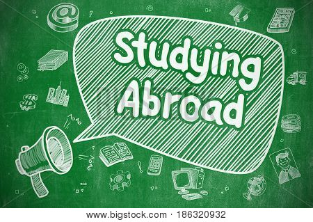 Studying Abroad on Speech Bubble. Doodle Illustration of Yelling Megaphone. Advertising Concept. Business Concept. Loudspeaker with Text Studying Abroad. Doodle Illustration on Green Chalkboard.