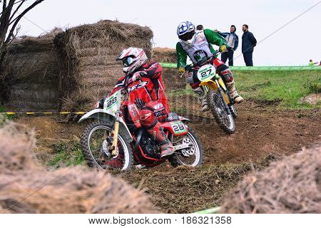 Unidentified Racers Rides A Classic Motorcycle.