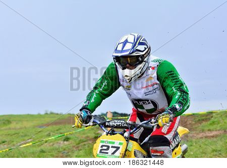 Unidentified Racer Rides A Classic Motorcycle.