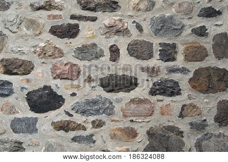 stone wall fieldstone and concrete natural building texture