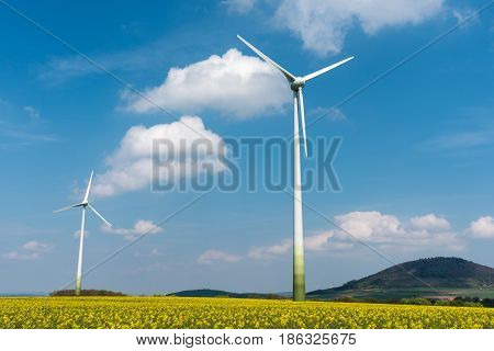 Windmills in a rapeseed field seen in Germany
