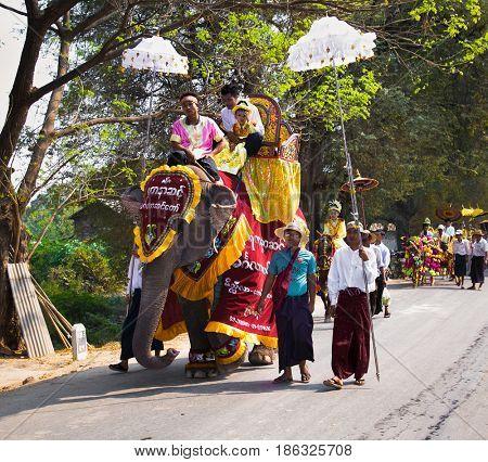 INNWA, MYANMAR-MARCH 6, 2017: Burmaneses at Shinbyu (pabbajja) ceremony of Theravada Buddhism in Innwa on March 6, 2017, Mandaley. Myanmar. (Burma)