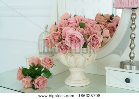 Bouquet Of Pink Rores In Vase On White Boudoir Table With Oval Mirror. Detail Of The Interior Of The