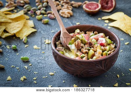 Baked Soft Cheese Brie With Figs, Walnuts, Pistachios And Honey In A Bowl With Wooden Spoon. Snack C