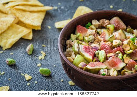 Raw Chopped Figs, Walnuts, Pistachios And Honey With Soft Cheese In A Bowl. Snack Concept With Chips