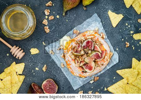 Melted Baked French Soft Cheese From Brittany Region Covered With Chopped Figs, Walnuts And Honey On