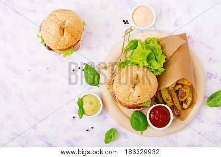 Big Sandwich - Hamburger With Juicy Beef Burger, Cheese, Tomato, And Red Onion On Light Background A