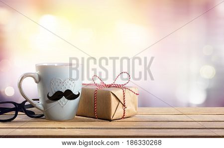 A Present For Fathers Day - Gift With Glasses And Coffee cup On Table