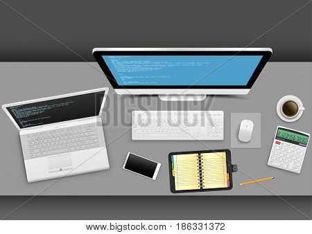 Workplace from above on gray office table. White modern computer laptop smartphone notebook organizer calculator coffee with shadow on gray background. Business concept