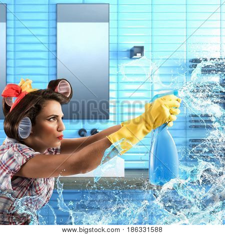 Housewife cleans determined with much cleaner spray