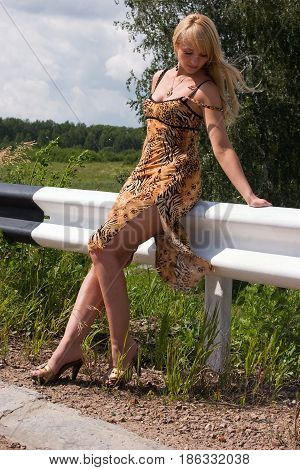 Beautiful young woman on the side of the road.