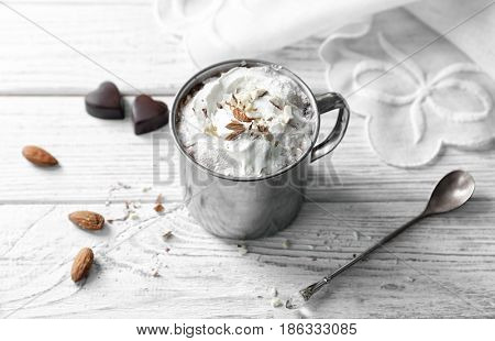 Cup of hot cocoa drink on wooden table