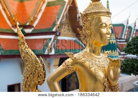 Beautiful Ki-nara Angel Stand Front Of Pagoda Temple In Bangkok As A Tourist Destination. Thai Angel