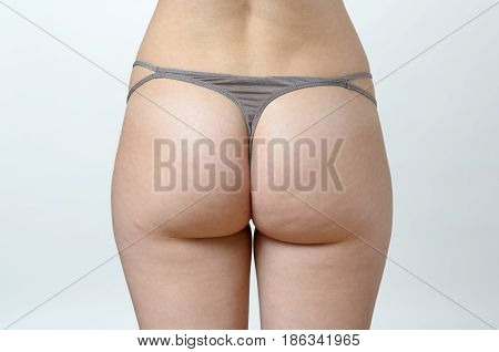 Firm Buttocks Of A Shapely Young Woman