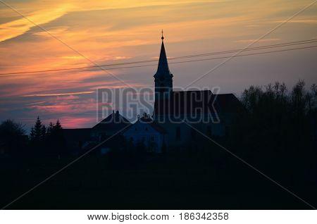 Sunset Church of St. Jacob village Hurky southern Bohemia Czech Republic