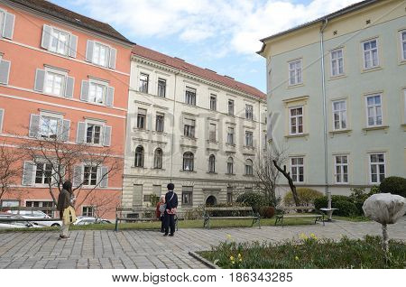 GRAZ, AUSTRIA - MARCH 19, 2017: A few people at a plaza round about the cathedral in Graz the capital of federal state of Styria Austria.