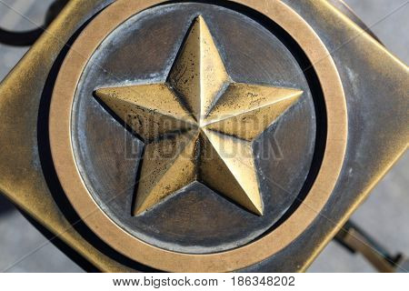Details of metal star at a guard