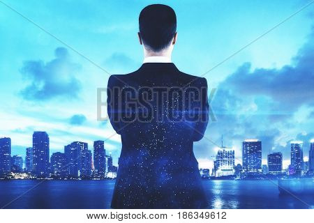 Back view of young man with space suit looking at city with. Creativity concept