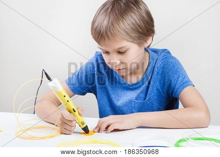Kid using 3d printing drawing pen. Creative, leisure, technology education concept