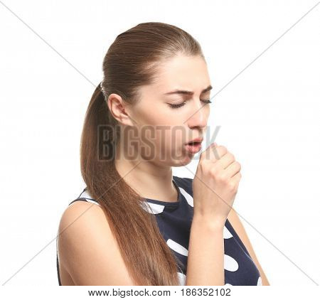 Young woman suffering from cough on white background