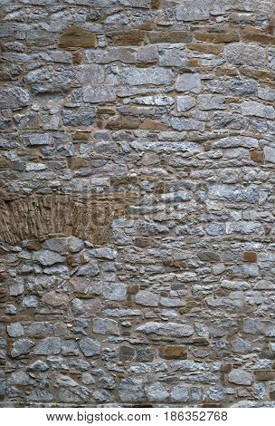 masonry walls made of old stones background for designer.