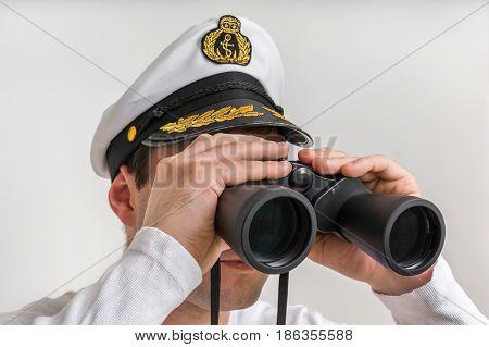Captain Looks Through A Binoculars