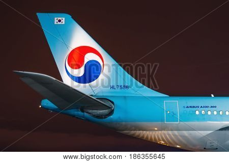 Night view of the airport and the tail plane Korean air. Russia Saint-Petersburg April 2017