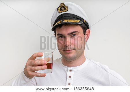 Captain With Sailor Cap Holding Glass Of Whisky