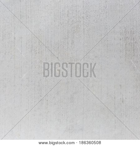 Grey concrete wall background with vertical streaks