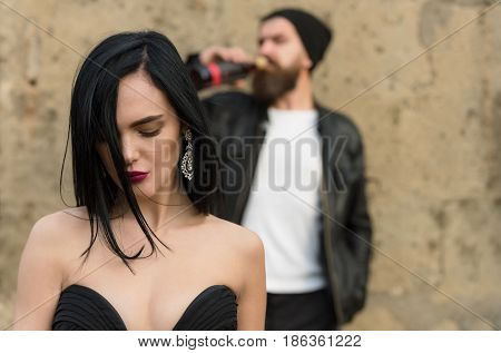 Unhappy Sexy Girl And Blurred, Brutal Man Drinking Wine
