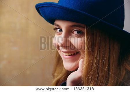 Happy Smiling Girl In Retro Blue Hat And Blonde Hair