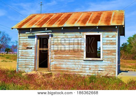 Haunting image of an abandoned dilapidated cabin taken in the rural countryside