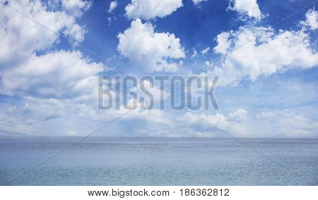 Blue sky and sea background - A few clouds on the sky