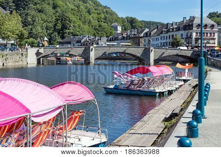 Medieval city Bouillon with river Semois and pedalos for hire in Belgian Ardennes