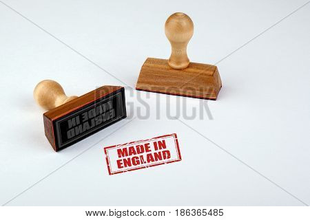 Made in England. Rubber Stamper with Wooden handle Isolated on White Background.