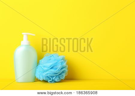 Cosmetic Bottle With Wisp On Yellow Background