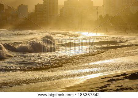 Sunset on the sands of Ipanema beach in Rio de Janeiro