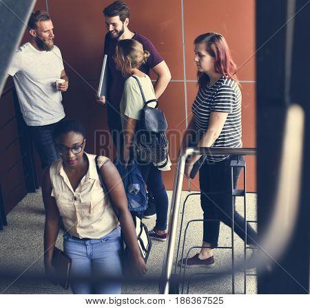 People Talking at Stairway During Break Time