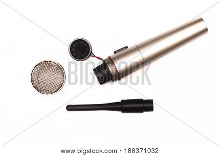 Microphone isolated on white background. Disassembled microphone top view.