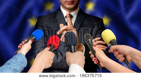 European Candidate Speaks To Reporters - Journalism Concept