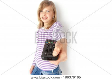Disappointed TV viewer turning off the television with a remote control. Isolated on white.