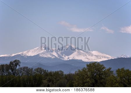 Snow Covered Rocky Mountains with blue sky