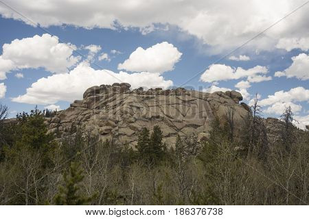 Rocks at Vedauwoo Park in Wyoming under cloudy blue sky