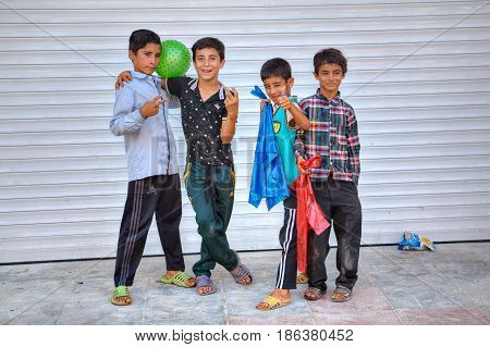 Bandar Abbas Hormozgan Province Iran - 16 april 2017: Four boys of teenage friends twisted and gesticulated at the sight of a tourist with a camera.