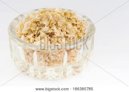 Quinoa flakes (Chenopodium quinoa) isolated on white background