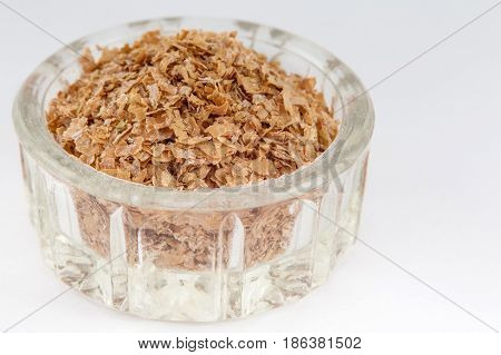 Wheat bran (Triticum aestivum) isolated on white background
