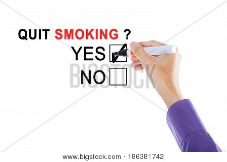 Picture of businessman's hand choosing a yes option with a marker for quit smoking on the whiteboard